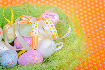Easter ribbon and eggs in nest