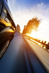 car on the road with motion blur background.