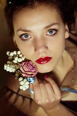 Portrait of beautiful young woman with flowers. Romantic style/