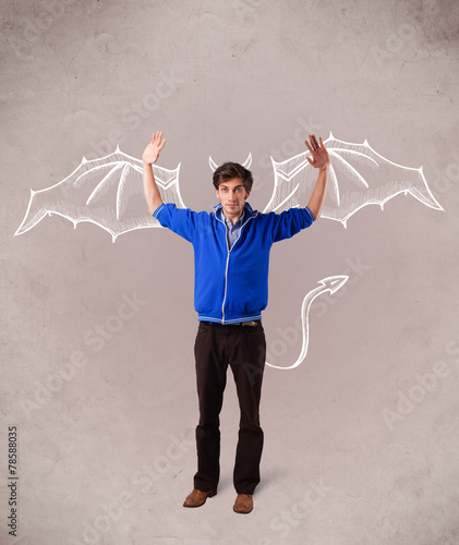 canvas print picture Young man with devil horns and wings drawing