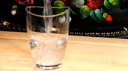 Glass of water on the wooden table