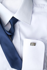 Man's white shirt with blue tie and cufflinks