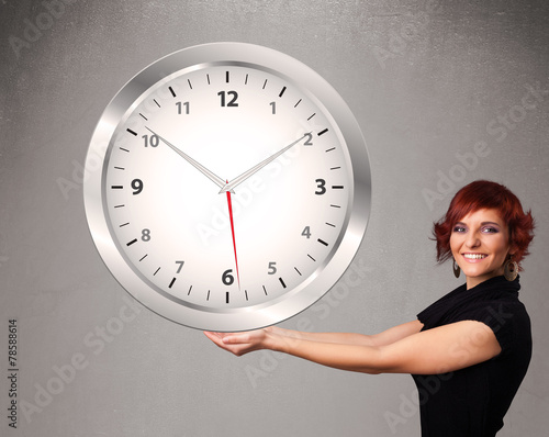 canvas print picture Attractive lady holding a huge clock