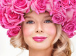 Fashion Beauty Model Girl with Pink Roses. Bouquet of Beautiful
