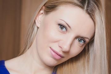 Portrait of young beautiful blond woman - head shot