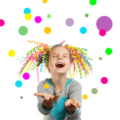 Joyful girl catches multi-colored confetti