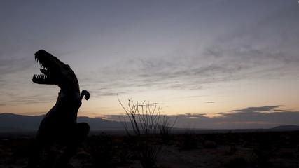 4K time lapse close up desert sunrise dinosaur silhouette