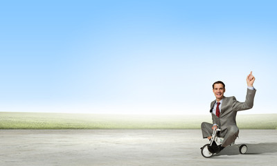 Business man riding bike