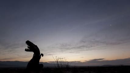 4K time lapse desert sunrise dinosaur silhouette