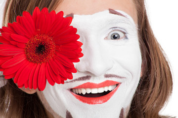 mime actor with red flower on his face