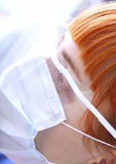 Portrait of pensive female doctor looks away