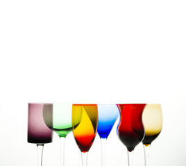 Colorful cocktail glases on a white background
