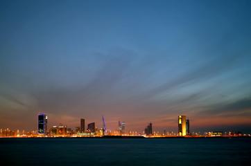 Bahrain skyline and the dark cloud during dusk