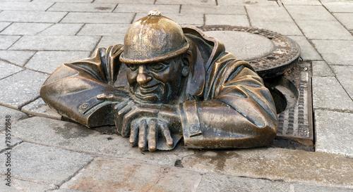 Leinwanddruck Bild bronze sculpture called man at work, Bratislava, Slovakia
