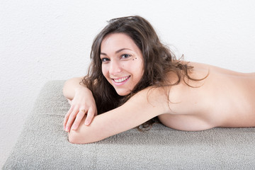 Beautiful and young woman relaxing on massage table