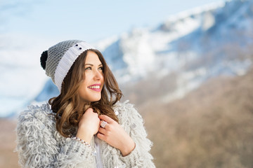 Beautiful fashionable woman in winter outfit outdoors