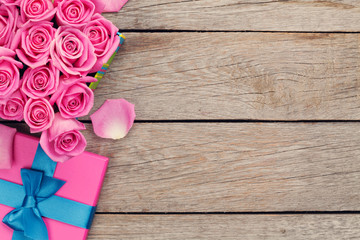 Valentines day background with gift box full of pink roses