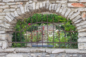 stone arch with a lattice fence