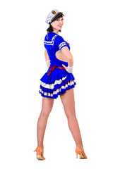 young dancer woman dressed as a sailor posing on an isolated