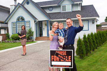 Young family celebrate buying a new home