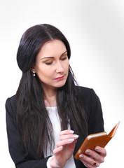 Businesswoman reading electronic organizor