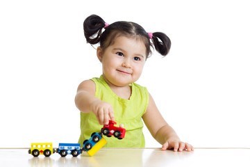 Cute little girl playing trains