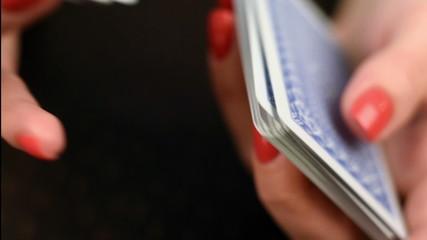 croupier shuffling cards, close up