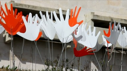 Many waving abstract hands signs or flags