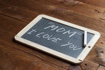 Mom I love you written on blackboard