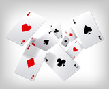 Playing cards. Poker aces flying insolated on gray background.