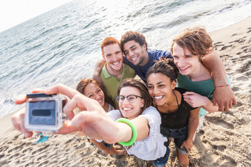 Multiracial Group of Friends Taking Selfie at Beach