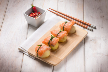 homemade sushi with potatoes and fresh salmon
