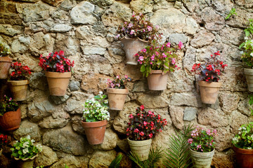 Stone house wall with flowers