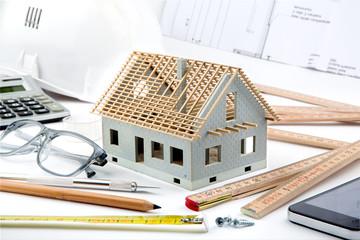 House miniature under construction on an architect desk