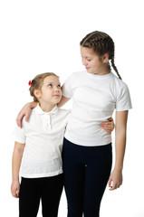 Little girls hugs on white
