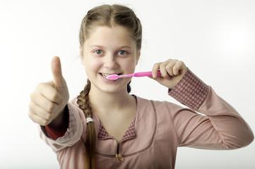 Cute girl brushing teeth on white