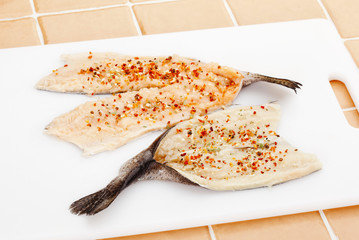 cooking fish fillets with spices