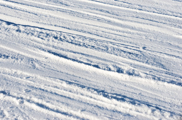 Closeup photo of skis marks on snow slope
