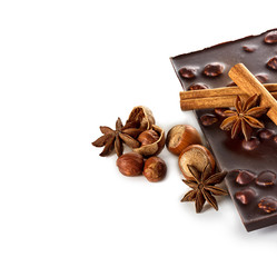 Chocolate and nuts with cinnamon sticks, star anise isolated