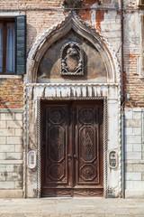 Detail of a door in Venice, Italy.