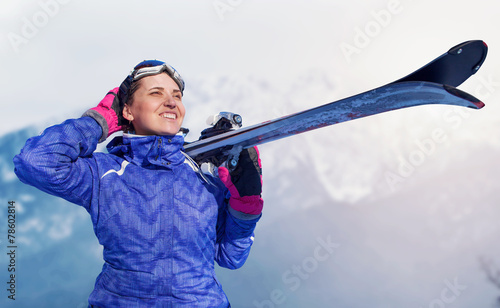 Active girl with snowboard on the snow mountain view - 78602814
