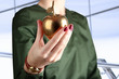 Businesswoman  standing  and holding golden  apple in his hand.