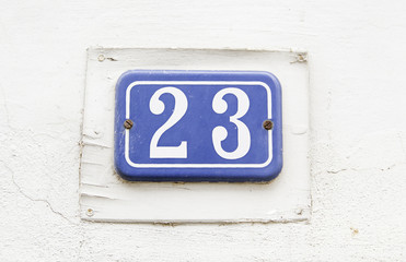 Number twenty-three on the wall of a house