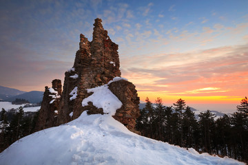 Ruin of a castle on a winter evening, Slovakia.