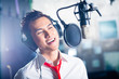 Asian male singer producing song in recording studio - 78605080