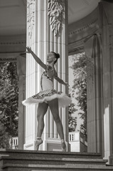 Beautiful young ballerina dancing, standing in pointe position.