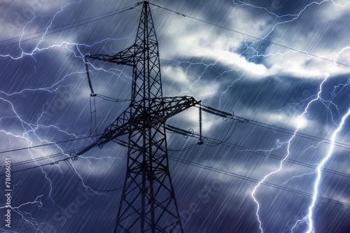 Leinwanddruck Bild High voltage tower and lightning