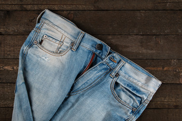 Jeans on wooden surface