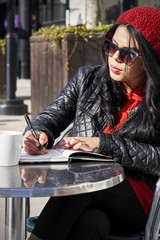 Young woman writting on a notebook