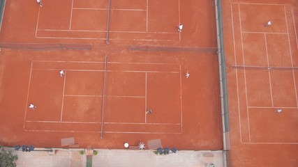 High aerial view on people playing tennis.